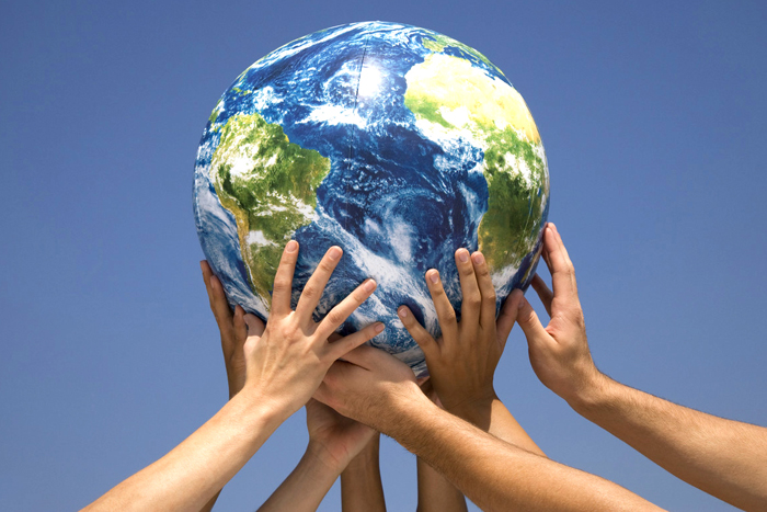 Hands holding up globe --- Image by © Tom Grill/Tetra Images/Corbis